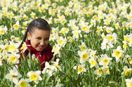 Girl child playing spring time field Stock Photos