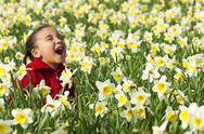 Young girl child playing spring time field Stock Photos