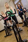 young women in spinning class - stock photo