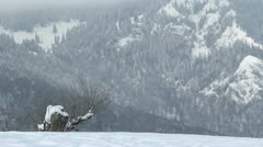 Furious wind dispelling the snow, mountains covered with snow Stock Footage