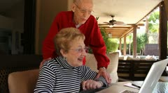 Happy Elderly Couple on laptop computer - stock footage