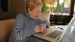 Elderly Woman on laptop computer Stock Footage
