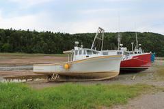 beached boats in alma, new brunswick - stock photo