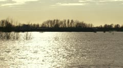 Ship sails on flooded River Rhine, The Netherlands. Stock Footage