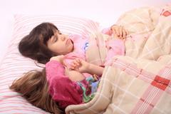 Little girls waking up Stock Photos
