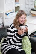 woman with a coffee cup in her hand - stock photo