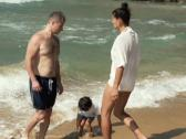 Family on the beach, super slow motion, shot at 240fps NTSC Stock Footage