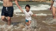 Family having fun on the beach, super slow motion, shot at 240fps HD Stock Footage
