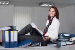 Businesswoman with a stack of files Stock Photos
