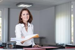 office clerk delivers documents - stock photo