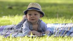 Smiling baby in the park, laughing toddler Stock Footage