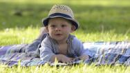 Stock Video Footage of Smiling baby in the park, laughing toddler
