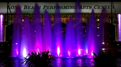 Long Beach Performing Arts Center With Fountain At Night Time Lapse Stock Footage