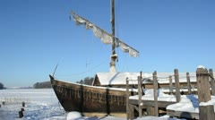 Retro wooden ship frozen lake ice pier sail move wind blue sky Stock Footage