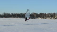 Follow ice surfer man catch wind sail frozen lake winter sport Stock Footage