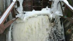 Water stream flow retro dam construction ice snow winter Stock Footage