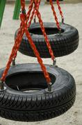 Swing made by tires Stock Photos