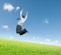 Stock Photo of man jumping on  meadow