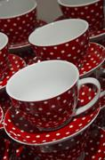Red cups and saucers Stock Photos