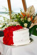Stock Photo of Wedding cake and flowers