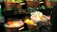 Young Woman Selects Vegetables in Grocery Store - stock footage