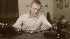 Vintage black telephone. Man dials Sepia Stock Footage