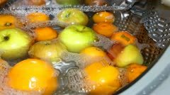 Oranges and apples in the drum. Stock Footage