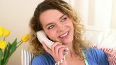 Caucasian catching up with a friend on the phone Stock Footage