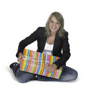 sitting cute girl with present - stock photo