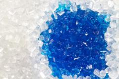 sugar macro with a blue wet spot - stock photo