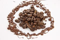 Surrounded coffee beans Stock Photos