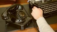 Desk. Vintage typewriter, old phone Stock Footage