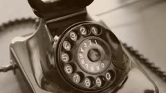 Vintage black telephone. Man dials Sepia - stock footage