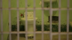 Prison jail cell rack focus toilet bars Stock Footage