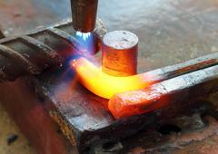 Gas heating cutting metal bending square bar Stock Photos