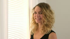 Smiling blonde woman with curly hair - stock footage