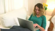 Blonde woman typing on her laptop Stock Footage