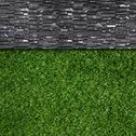 Wall background on green grass Stock Photos
