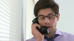 Stock Video Footage of Colleague talking on the phone