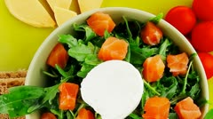 Fresh green salad with smoked salmon on plate Stock Footage