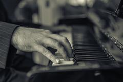 Hands of pianist playing the piano - stock photo
