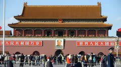 MaoZeDong portrait on Beijing Tiananmen Square,Chinese tourist in Street. Stock Footage