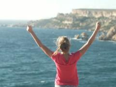 Happy excited woman by the sea, super slow motion, shot at 240fps NTSC Stock Footage