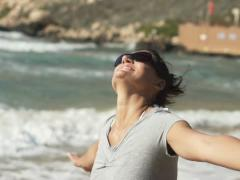 Happy excited woman on the beach NTSC Stock Footage