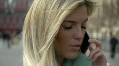 Blondie talking over the phone Stock Footage