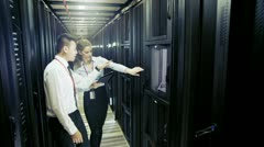 Team of IT engineers working in a data centre - stock footage
