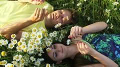 Couple among chamomiles Stock Footage