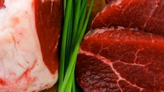 Raw meat : fresh beef pork big rib and fillet with garlic and green stuff Stock Footage
