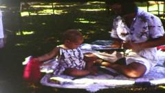 Girl Opening Presents at Her 1st Birthday Party (1983 Vintage 8mm Film) - stock footage