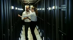 Team of IT engineers working in a data centre Stock Footage